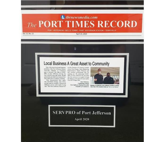 Port Times Record newspaper story cut out and on a black background