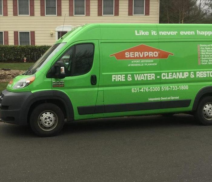 green SERVPRO van parked