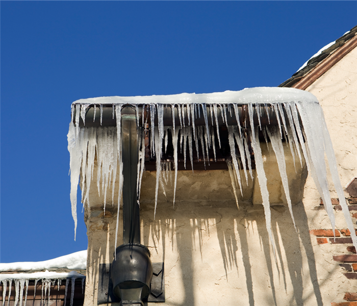 ice dam covering gutters of a house