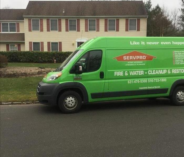 one of our technicians vans sitting outside a home