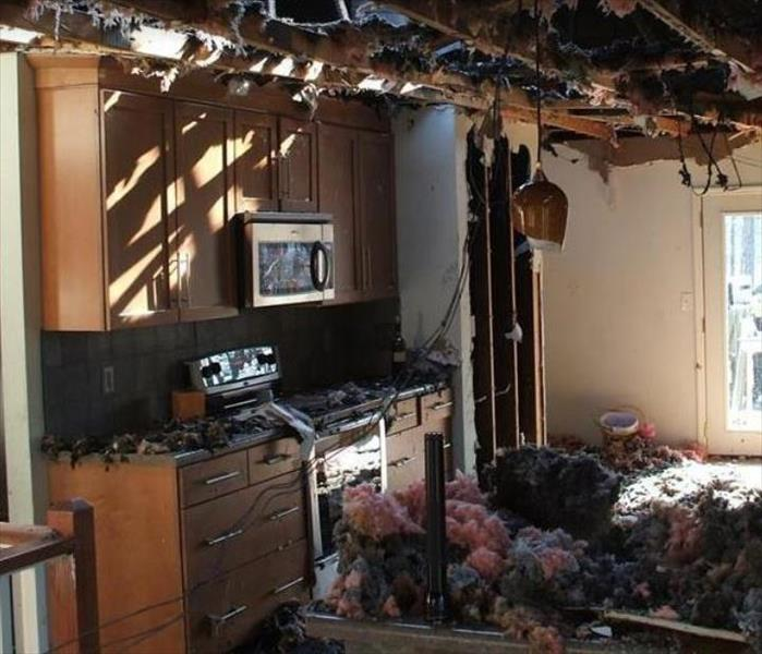 fire damaged kitchen.  Ceiling material on counter and floor.